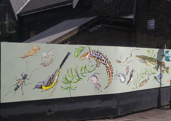 new river life mural at palmers green station