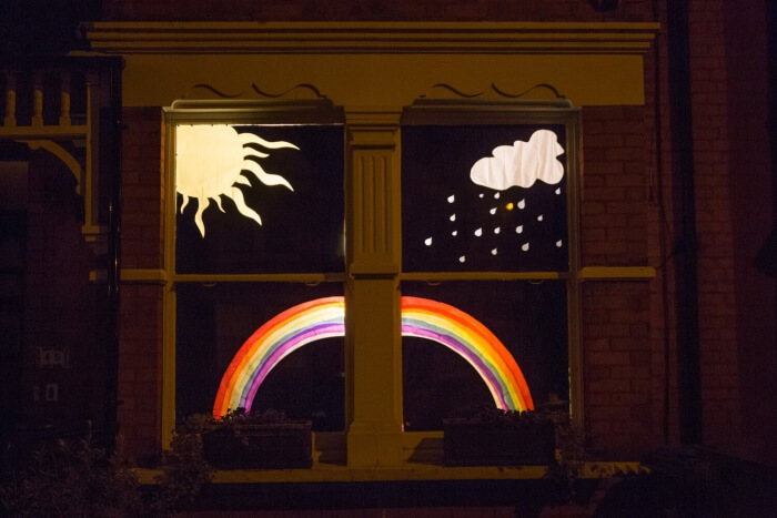 window display from the 2020 bounds green window show - rainbow sun and clouds