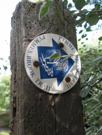 pymmes brook trail signpost in upper edmonton