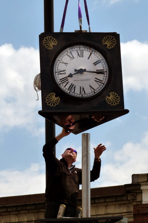 installation of new clock at Palmers Green Triangle