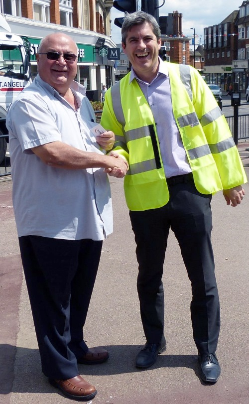 Costas Georgiou and Danny Hammond at the Palmers Green Triangle clock installation