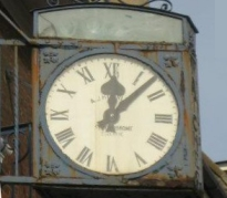 Photo of clock outside shop in Palmers Green